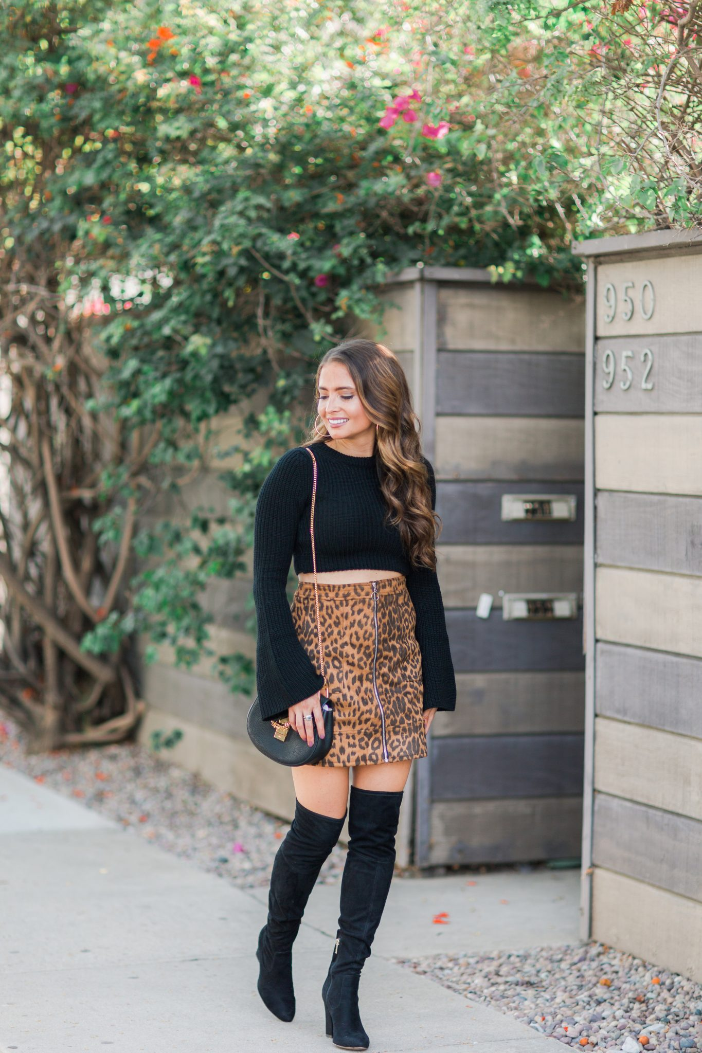 Maxie Elle | Leopard Skirt and OTK Boots - 27 Fun Facts About popular Orange County style blogger Maxie Elise