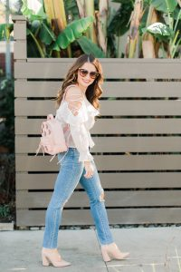Maxie Elle wearing pink flower backpack, lace-up top and Prada sunglasses - 3 Ways to Incorporate Florals Into Your Spring Wardrobe featured by popular Orange County fashion blogger, Maxie Elle