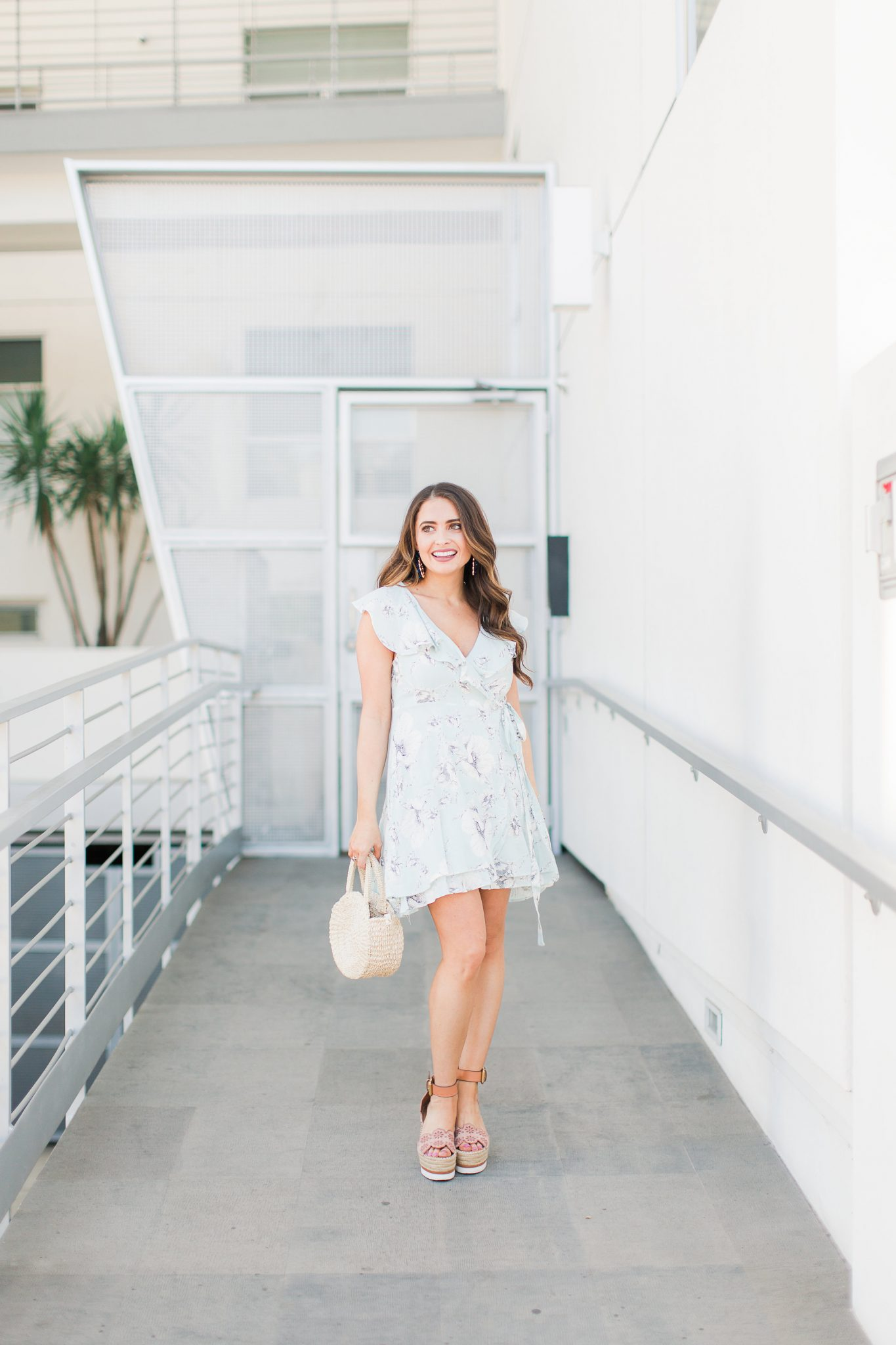 Blue floral wrap dress with flutter sleeves - My Favorite Cute Easter Dresses by popular Orange County fashion blogger Maxie Elise