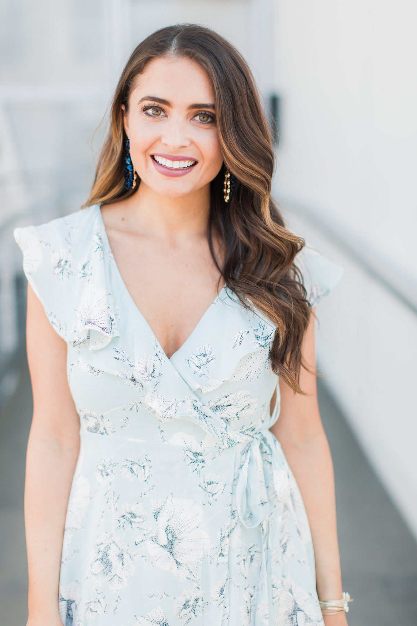 Blue floral wrap dress with ruffle detail - My Favorite Cute Easter Dresses by popular Orange County fashion blogger Maxie Elise