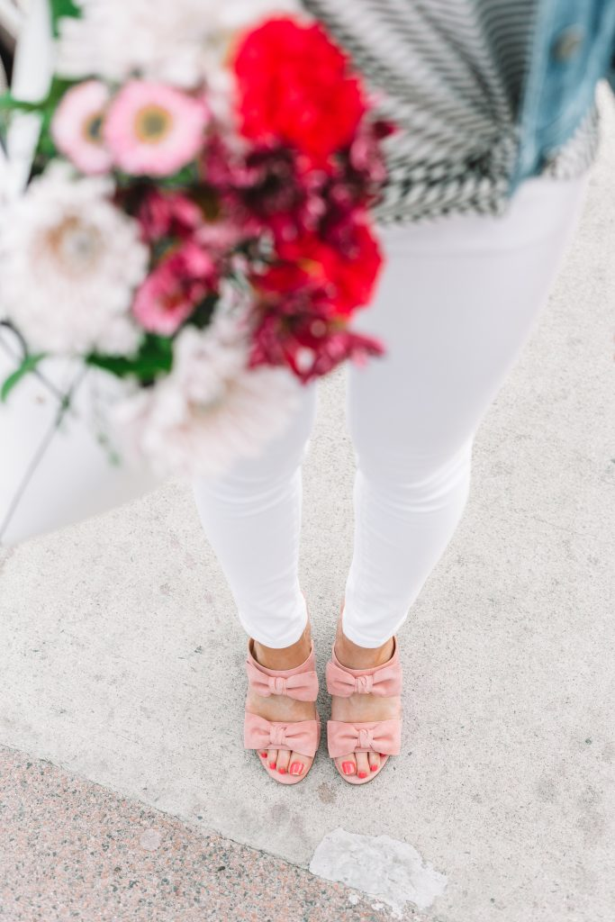 White jeans and pink bow shoes with flowers