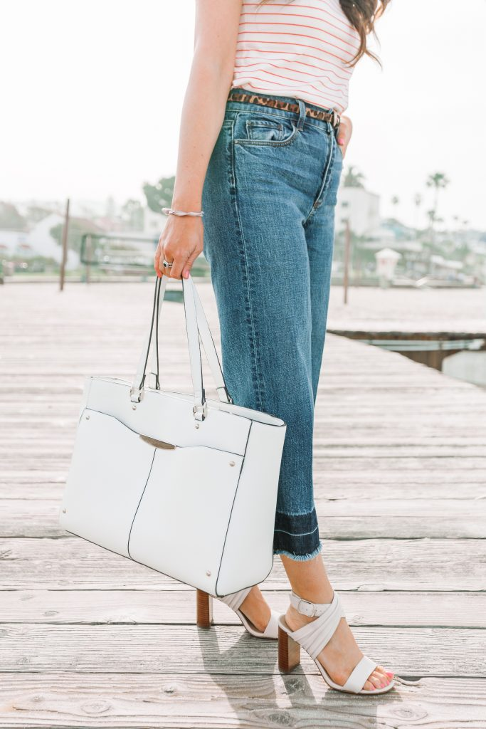 cropped denim and white bag