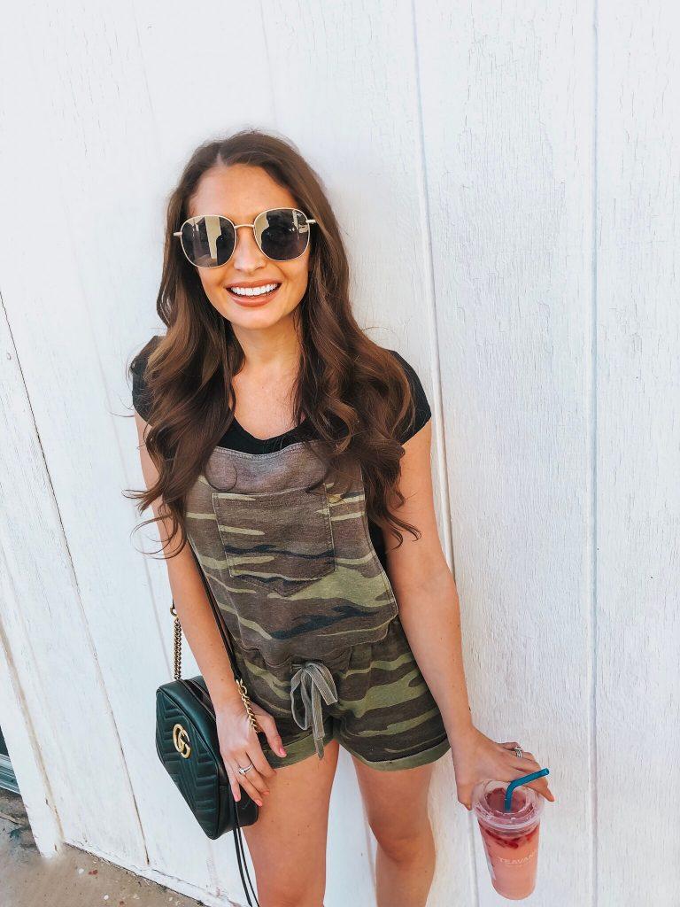 brunette girl wearing camo overalls