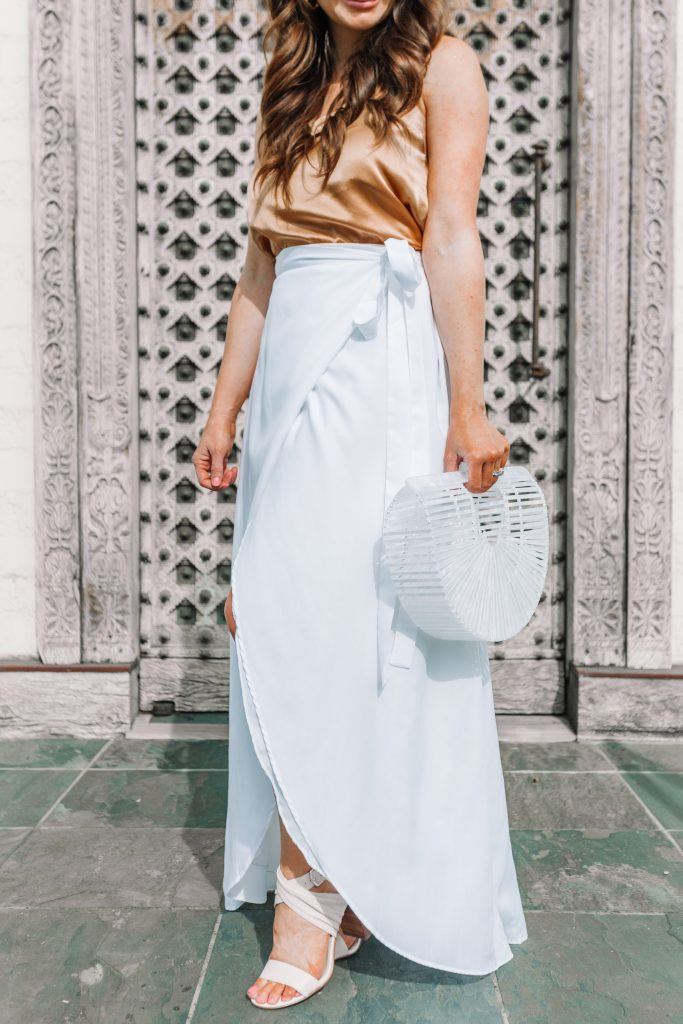 white maxi skirt and white acrylic arc bag